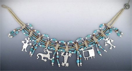 Necklace - Dance Of Petroglyphs- Five southwestern Indian petroglyphs adorn this collar made with turquoise nuggets, white brass African hishi and balled donuts.  #30530