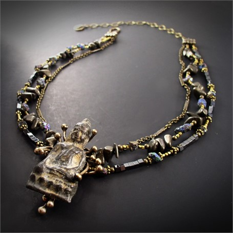 Necklace-Suspended Buddha- An antique Buddha is has in branches of bronze, and hangs from strands of chain, pyrite, quartz, brass and bronze beads.  #30510