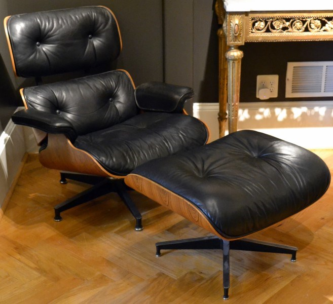 Armchair with ottoman by Charles and Ray EAMES A model number 670 and number 671 rosewood-faced moulded plywood