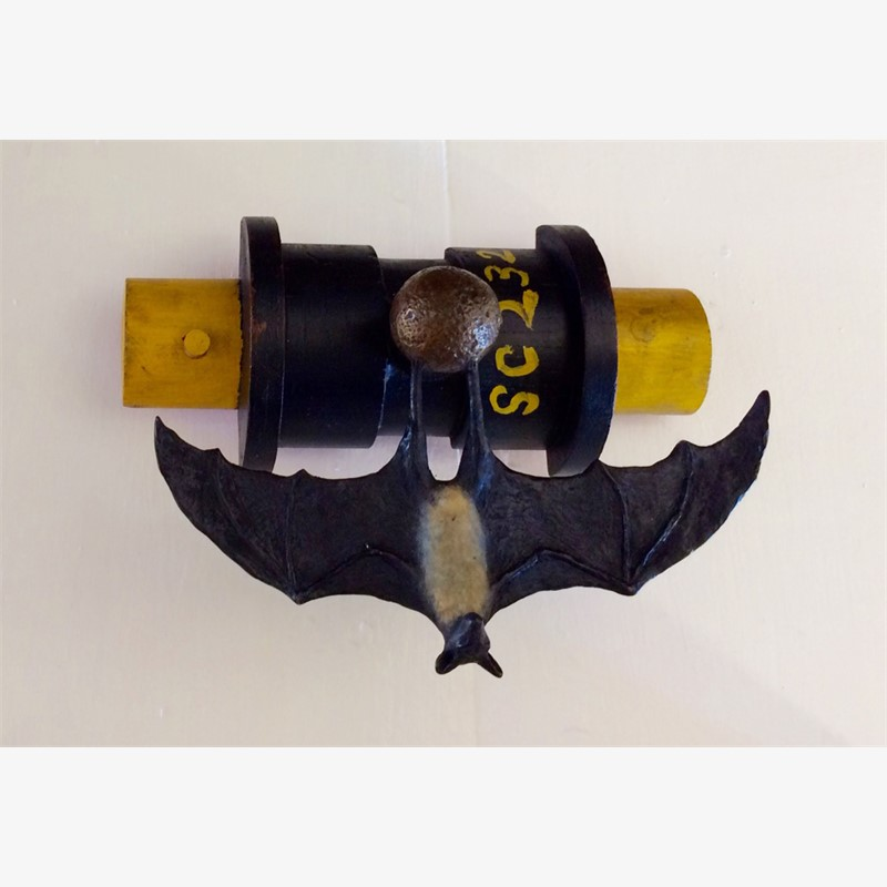 Industrial Bat on a Machine Mold