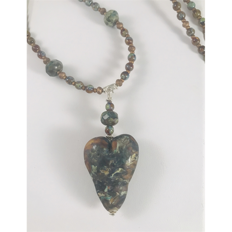 """Glass """"stone"""" with glass and seed beads by Linda Sacra"""