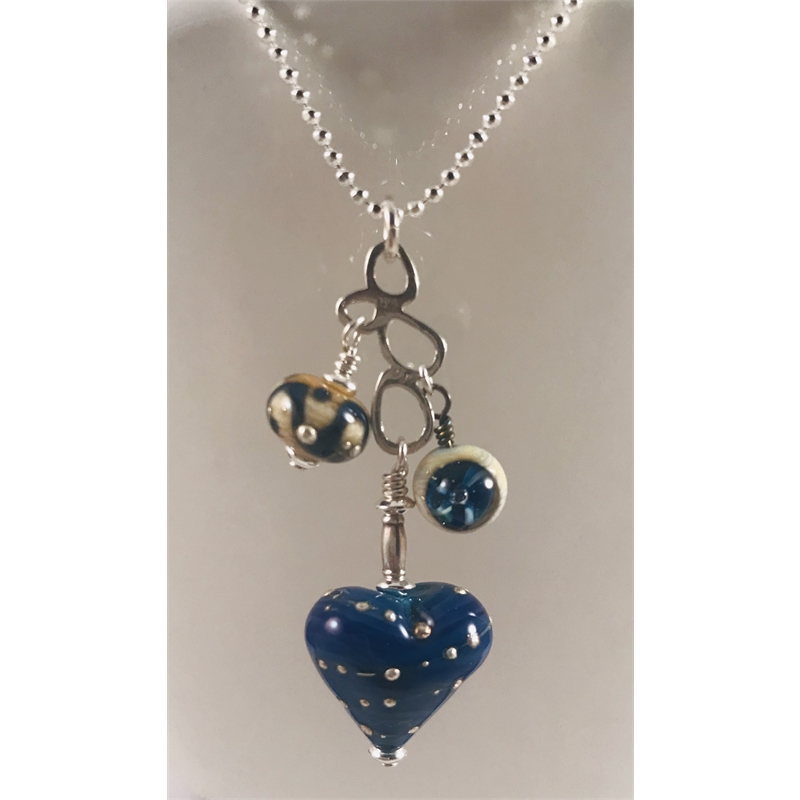 Blue glass heart with fine silver on sterling silver chain by Linda Sacra