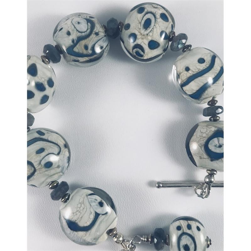 Ivory, white and blue lampworked beaded bracelet  by Linda Sacra