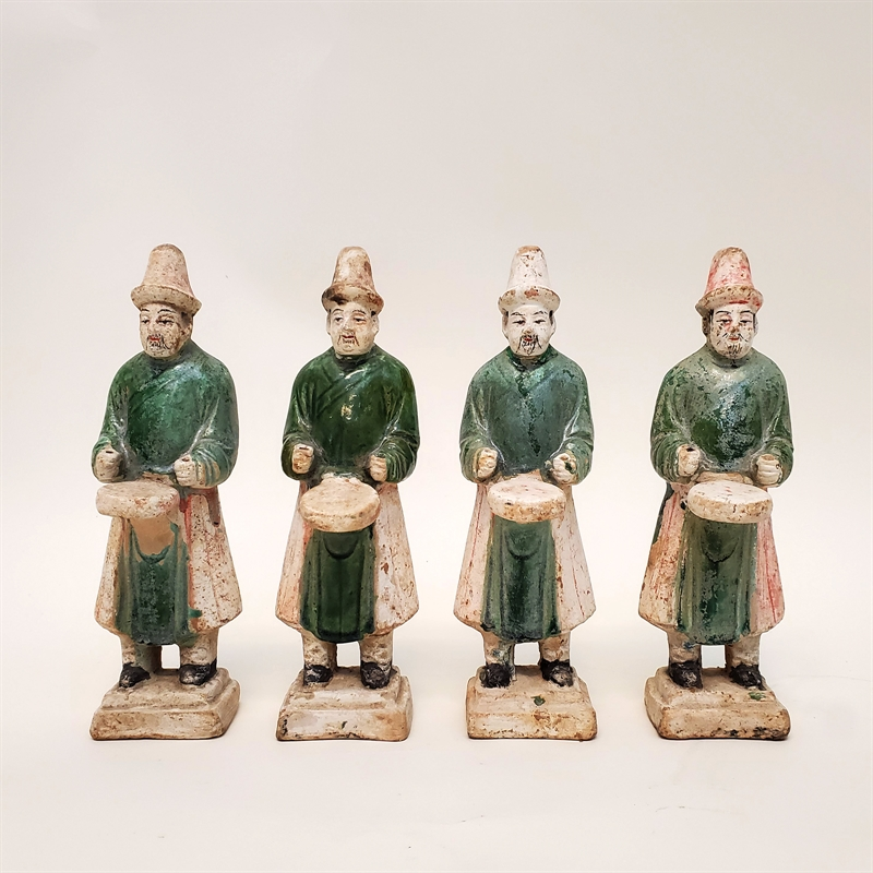 SET OF FOUR GREEN-GLAZED DRUMMERS , Ming Dynasty (1368-1644)