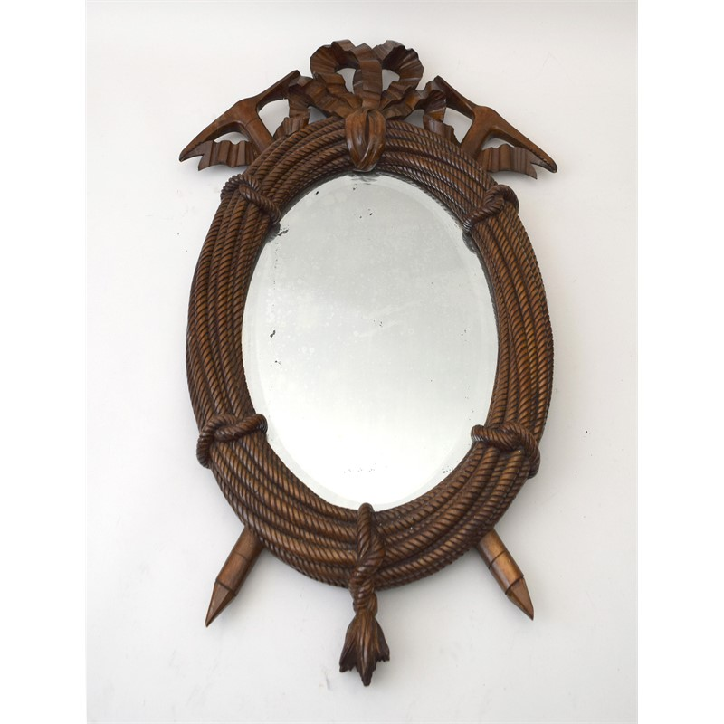 SMALL OVAL MIRROR CARVED WITH BOW-TIED COILED ROPE AND CROSSED PICK AXES, American, 20th century
