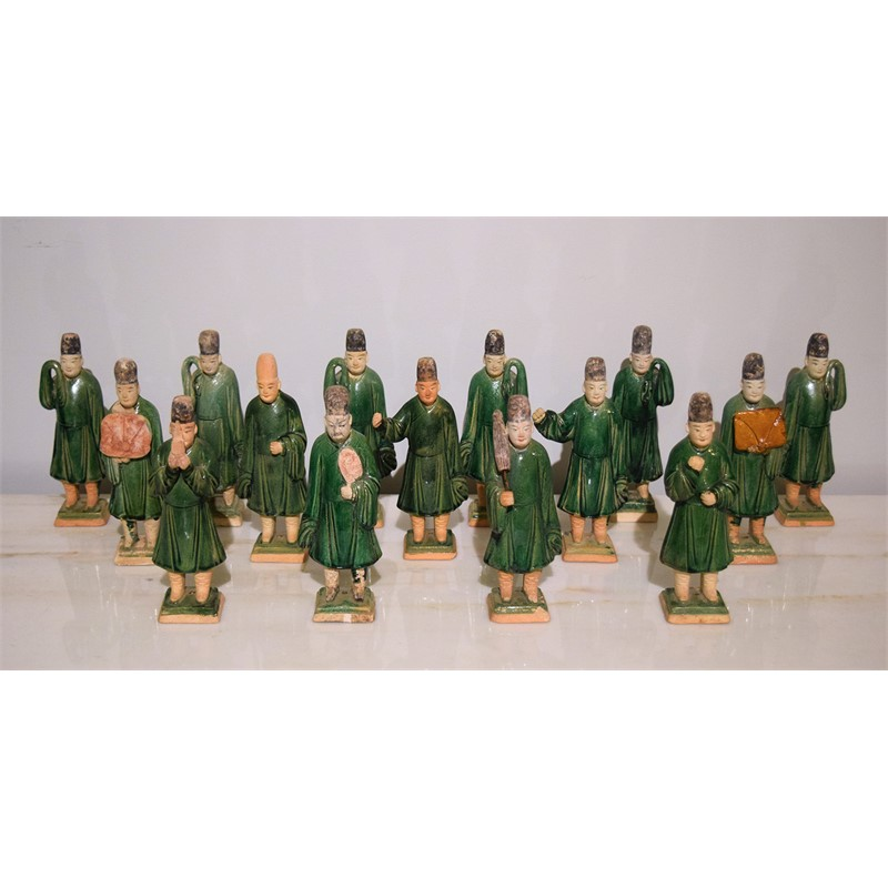 SET OF 15 GREEN-GLAZED POTTERY FIGURES WITH GLAZED BASES, Ming Dynasty (1368-1644)