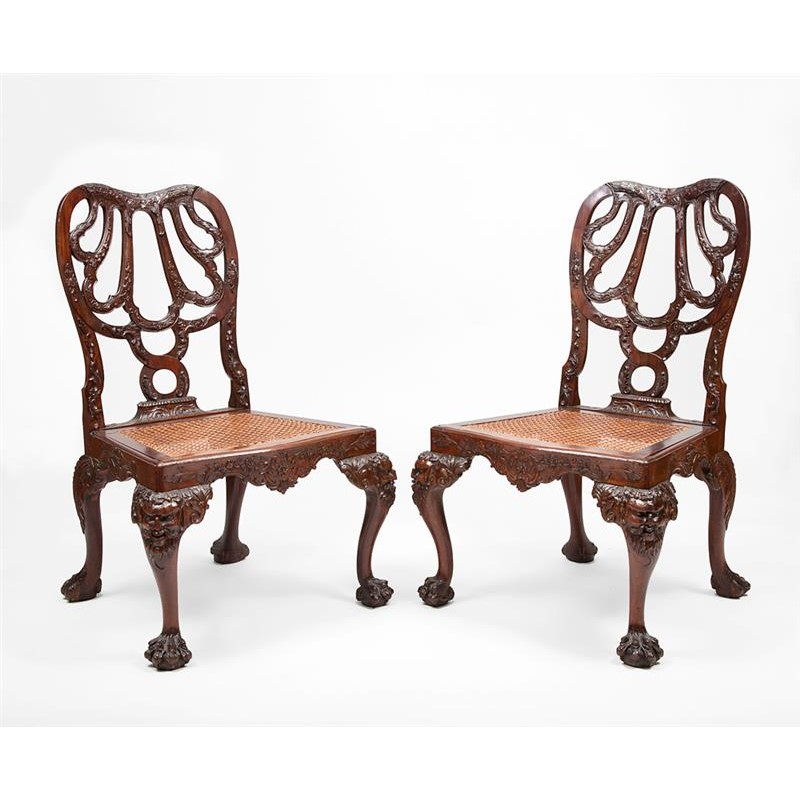 PAIR OF IRISH CARVED MAHOGANY AND CANED SIDE CHAIRS, Irish, 18th century