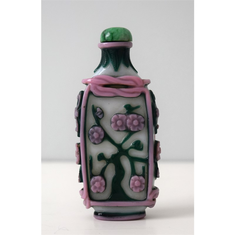 PINK AND GREEN OVERLAY ON A WHITE GROUND GLASS SNUFF BOTTLE, 19th century