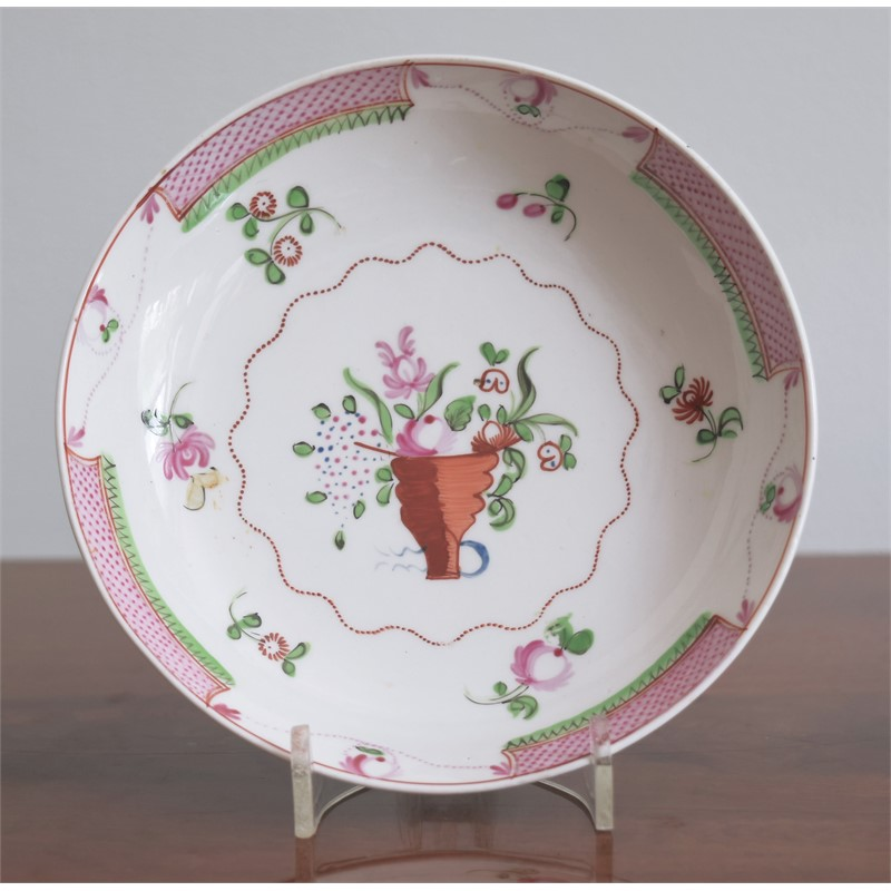 A BARBED FAMILLE ROSE SAUCER WITH FLORAL CORNUCOPIA, Qianlong Period (1736-1795)