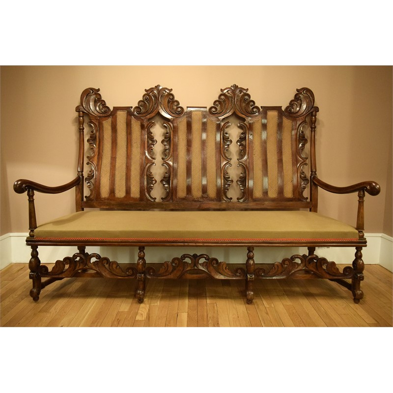 WALNUT AND CANED TRIPLE CHAIR-BACK SETTEE, Portuguese, 18th century