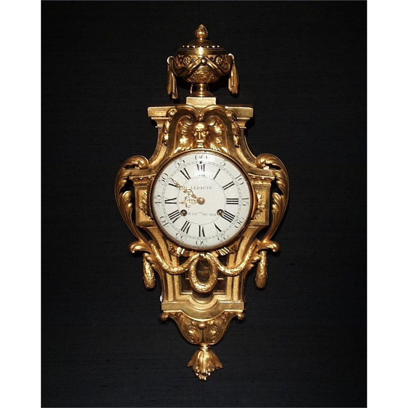 LOUIS XVI BRONZE CARTEL CLOCK WITH MASK AND GARLANDS BY LEPAUTE, French, 18th century