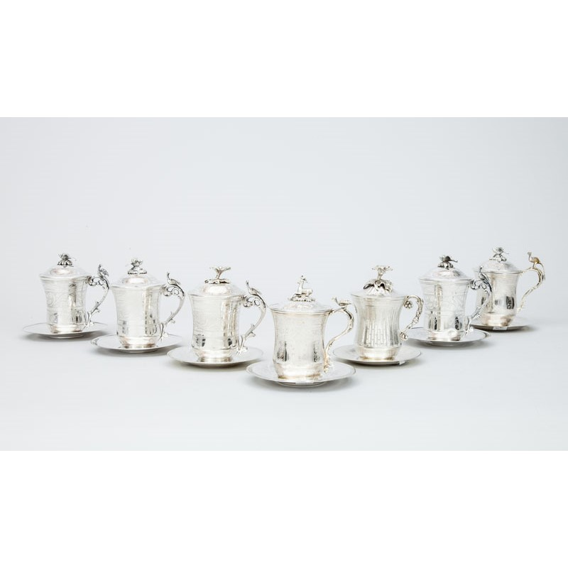 GROUP OF SEVEN STERLING SILVER TANKARDS WITH LIDS AND SAUCERS, Egypt and Turkey, 20th century