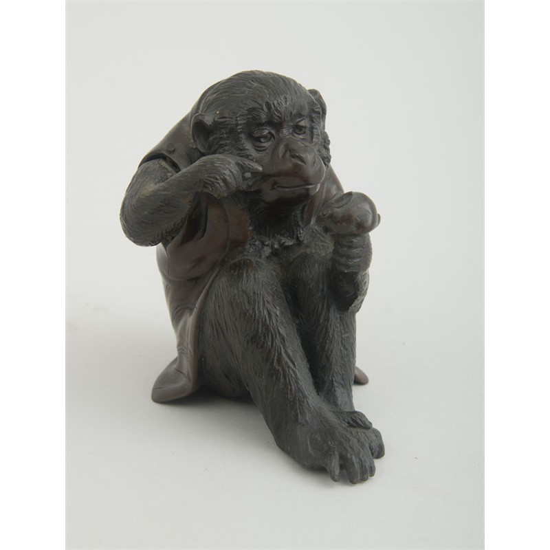 JAPANESE BRONZE FIGURE OF A SEATED SNOW MONKEY