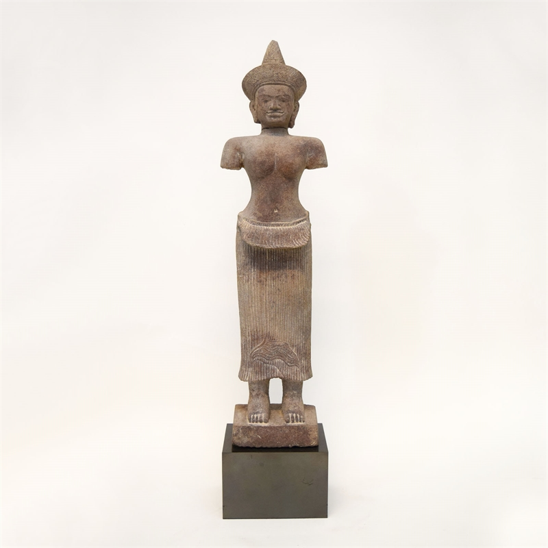 SANDSTONE FIGURE OF A FEMALE DEITY IN ANGKOR WAT STYLE, Khmer, 12th century