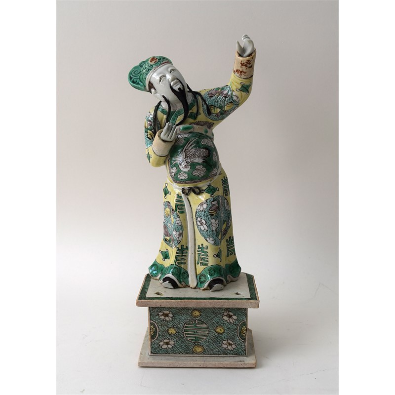 FAMILLE VERTE BISCUIT FIGURE OF AN ARCHER, Chinese, Kangxi Period (1662-1722)