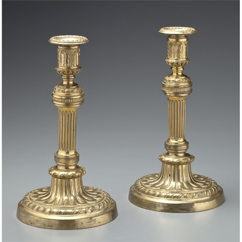 PAIR OF LOUIS XVI GILT-BRONZE CANDLESTICKS, French, 18th century