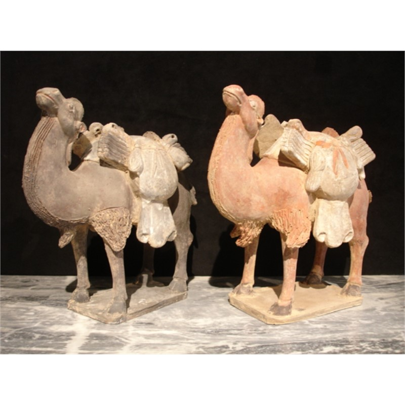 PAIR OF PAINTED POTTERY CAMELS
