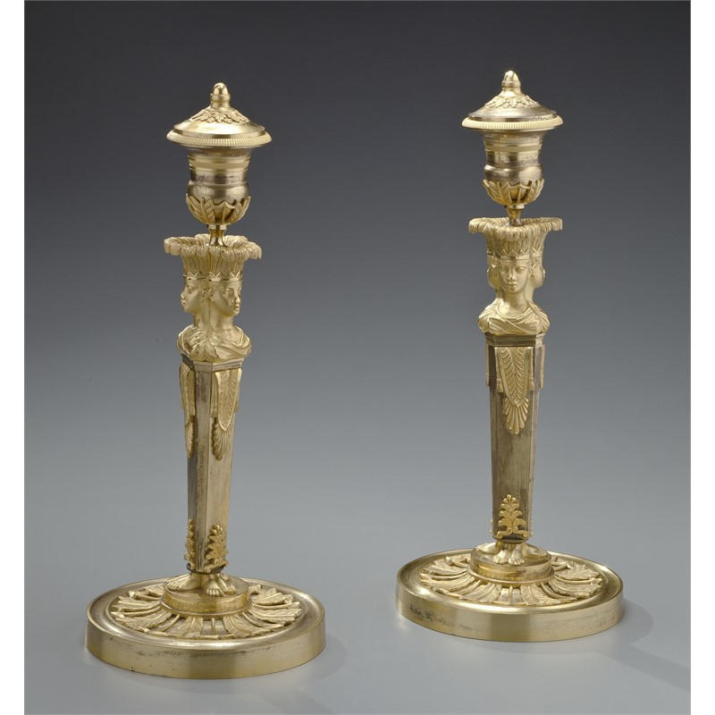 PAIR OF DIRECTOIRE GILT-BRONZE CANDLESTICKS, French, circa 1795