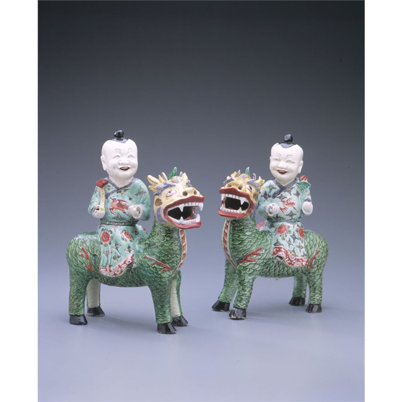 PAIR OF FAMILLE VERTE BISCUIT FIGURES OF BOYS ON QILINS, Chinese, Kangxi period, circa 1685-1700
