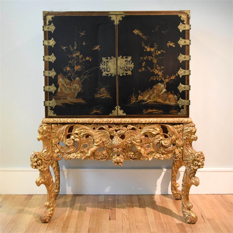 ENGLISH JAPANNED, PARCEL-GILT AND SILVERED CABINET ON GILTWOOD STAND, English, late 17th/early 18th century