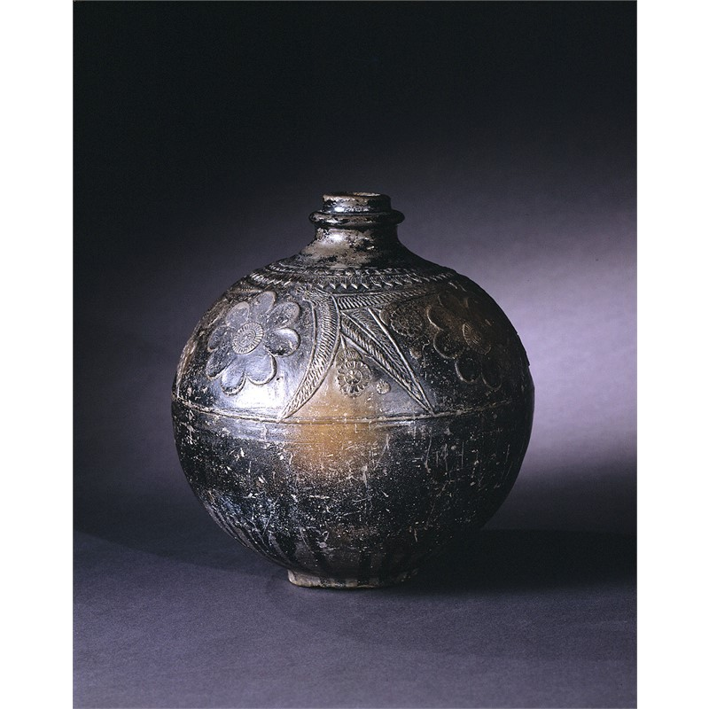 BLACK SLIP CERAMIC ROUND JAR WITH LOTUS AND ACANTHUS IN RELIEF, Chinese, Northern India, Sunga Dynasty, 1st century BC