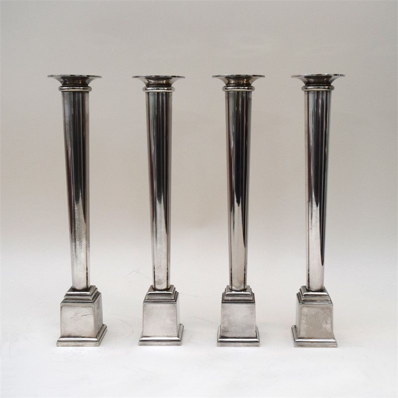 SET OF FOUR SWID POWELL SILVER PLATED CANDLESTICKS