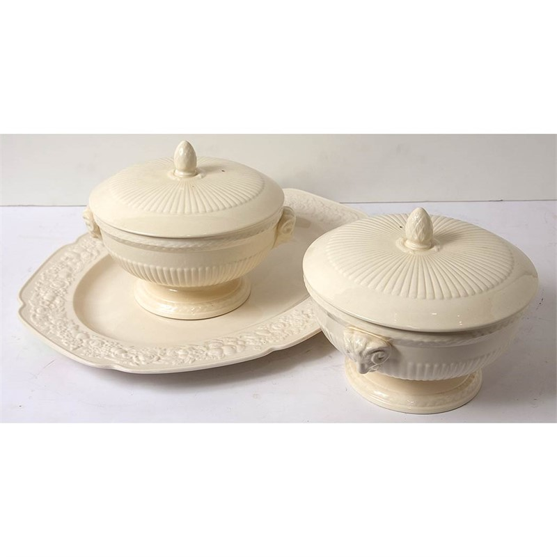 SET OF THREE WEDGWOOD CREAMWARE TUREENS; TOGETHER WITH TWO CROWN DUCAL PLATTERS