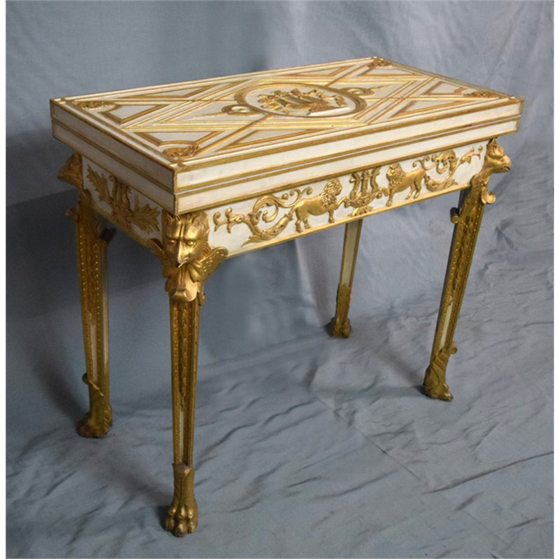 ITALIAN NEOCLASSICAL STYLE CARVED WHITE AND PACEL-GILT GAMES TABLE, Italian, 19th century