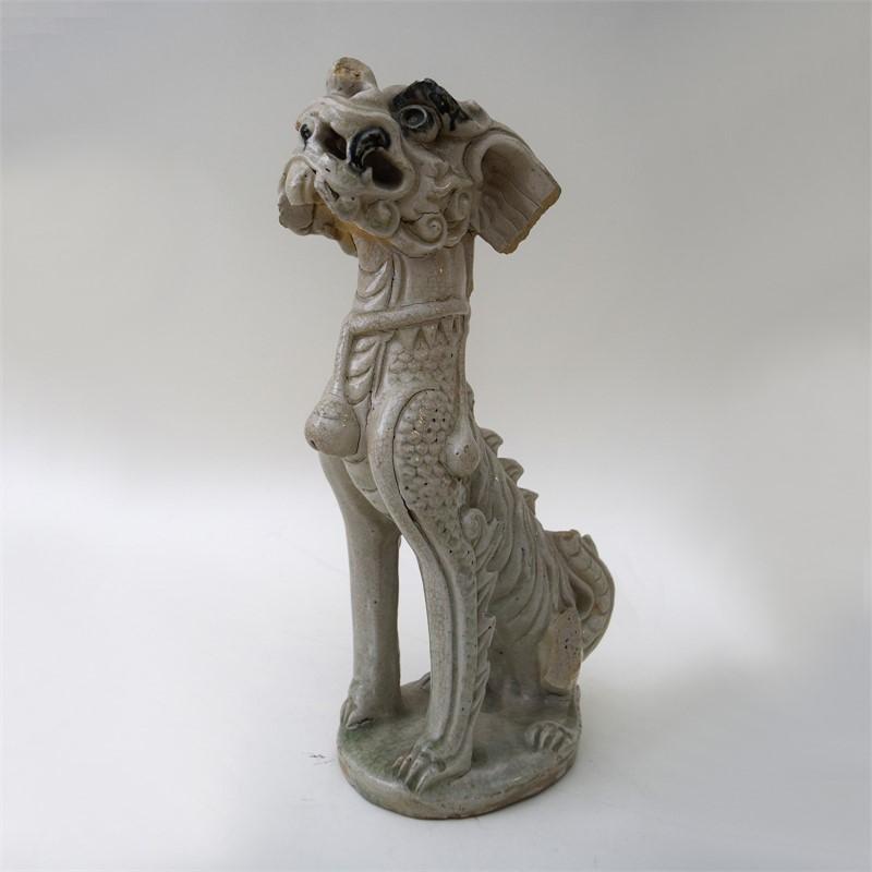 AN ANNAMESE THANH HOA WHITE GLAZED MYTHICAL BEAST, Vietnamese, 15th century