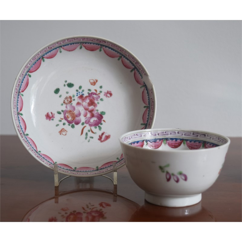 A FAMILLE-ROSE CUP AND SAUCER IN THE ENGLISH STYLE, circa 1750