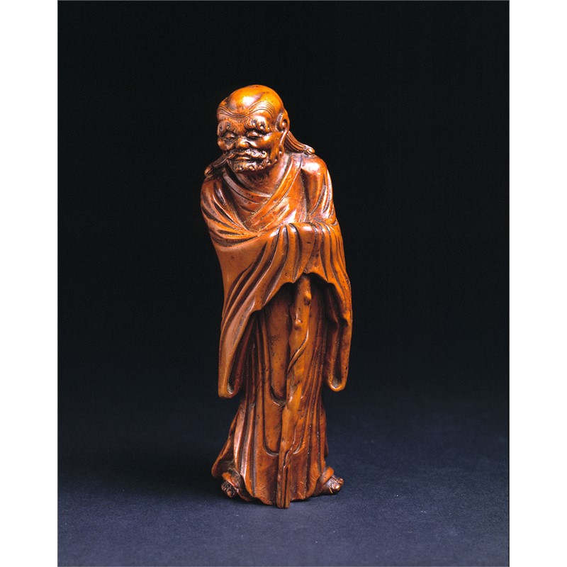 BOXWOOD CARVING OF A GENTLEMAN WITH STAFF, Chinese, 17th century