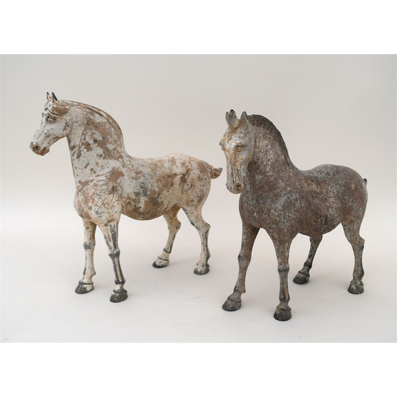 TWO PAINTED POTTERY HORSES, Chinese, Tang Dynasty (618-906 AD)