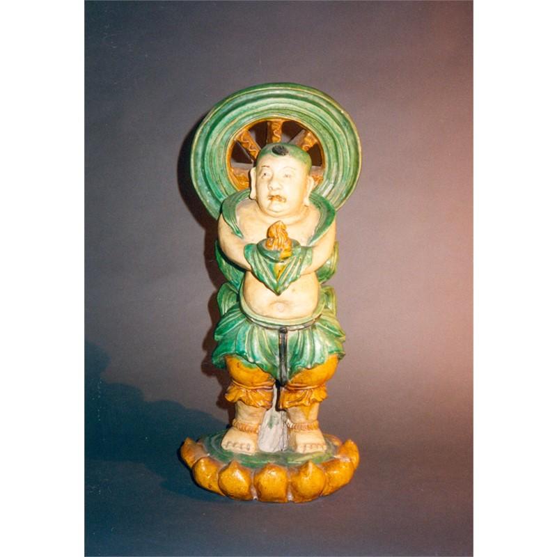 GLAZED POTTERY FIGURE OF A BOY, Ming Dynasty (1368-1644)