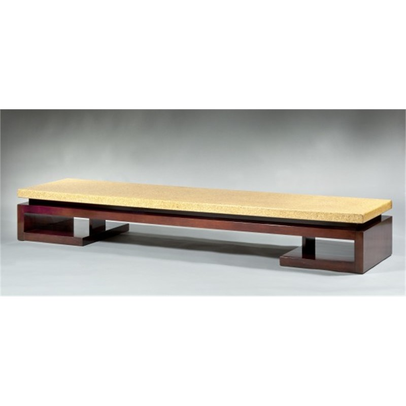 A LONG LOW TABLE WITH CORK TOP BY PAUL FRANKL, American, 20th century
