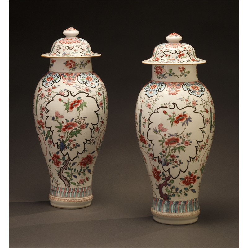 PAIR OF FAMILLE ROSE VASES AND COVERS, Qing Dynasty, mid-18th century