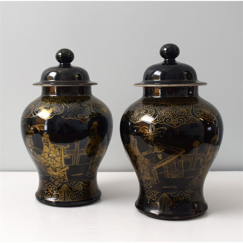 PAIR OF BLACK GROUND AND GILT BALUSTER JARS AND COVERS WITH FIGURES, Chinese, 19th century