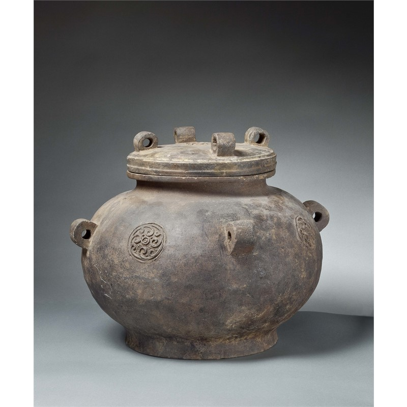 LARGE GREY POTTERY JAR AND COVER WITH MEDALLIONS AND RINGS, Chinese, Zhou Dynasty (1100-256 BC)