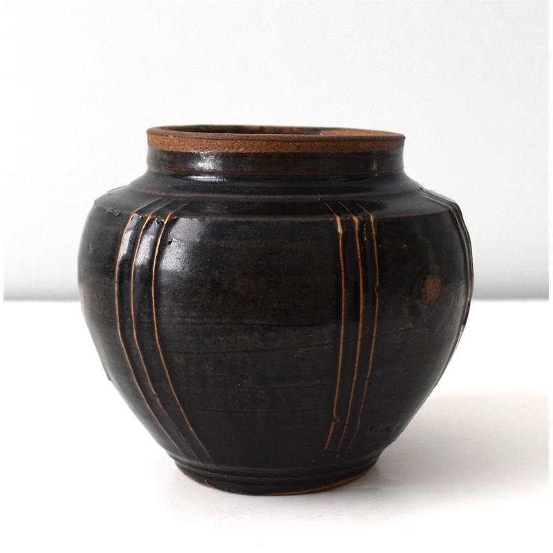 SMALL BLACK GLAZED RIBBED JAR, Chinese, Song Dynasty (970-1279)