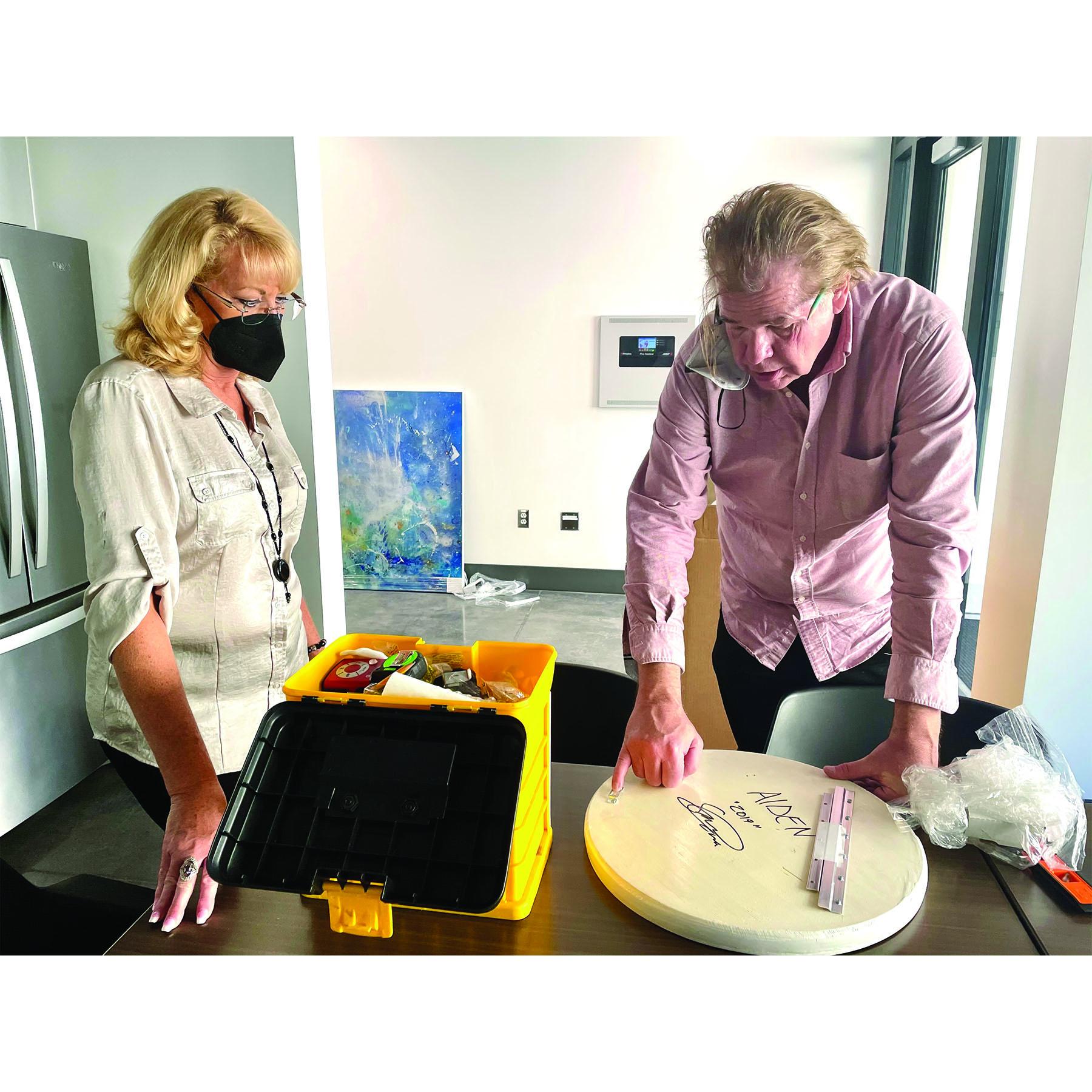 Michael Murphy and assistant plan an art install